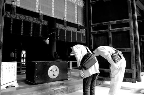 Showing respect at Futarasan shrine