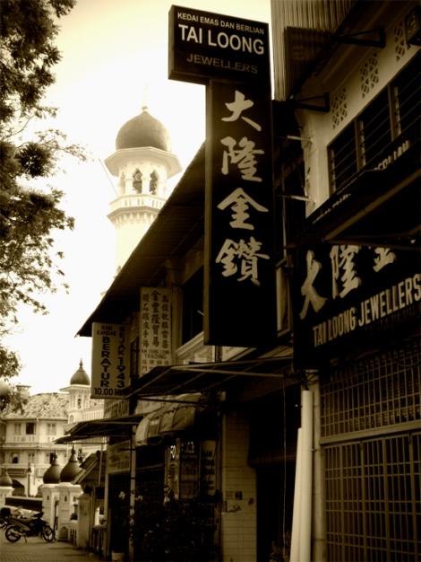 Chinese signs with the mosque in the background