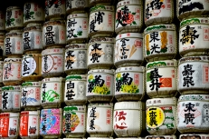 Vast rows of beautifully decorated sake barrels