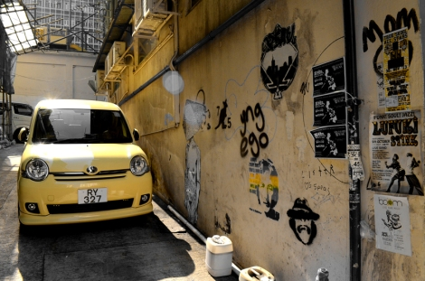Car & graffiti in a narrow Sheung Wan alley